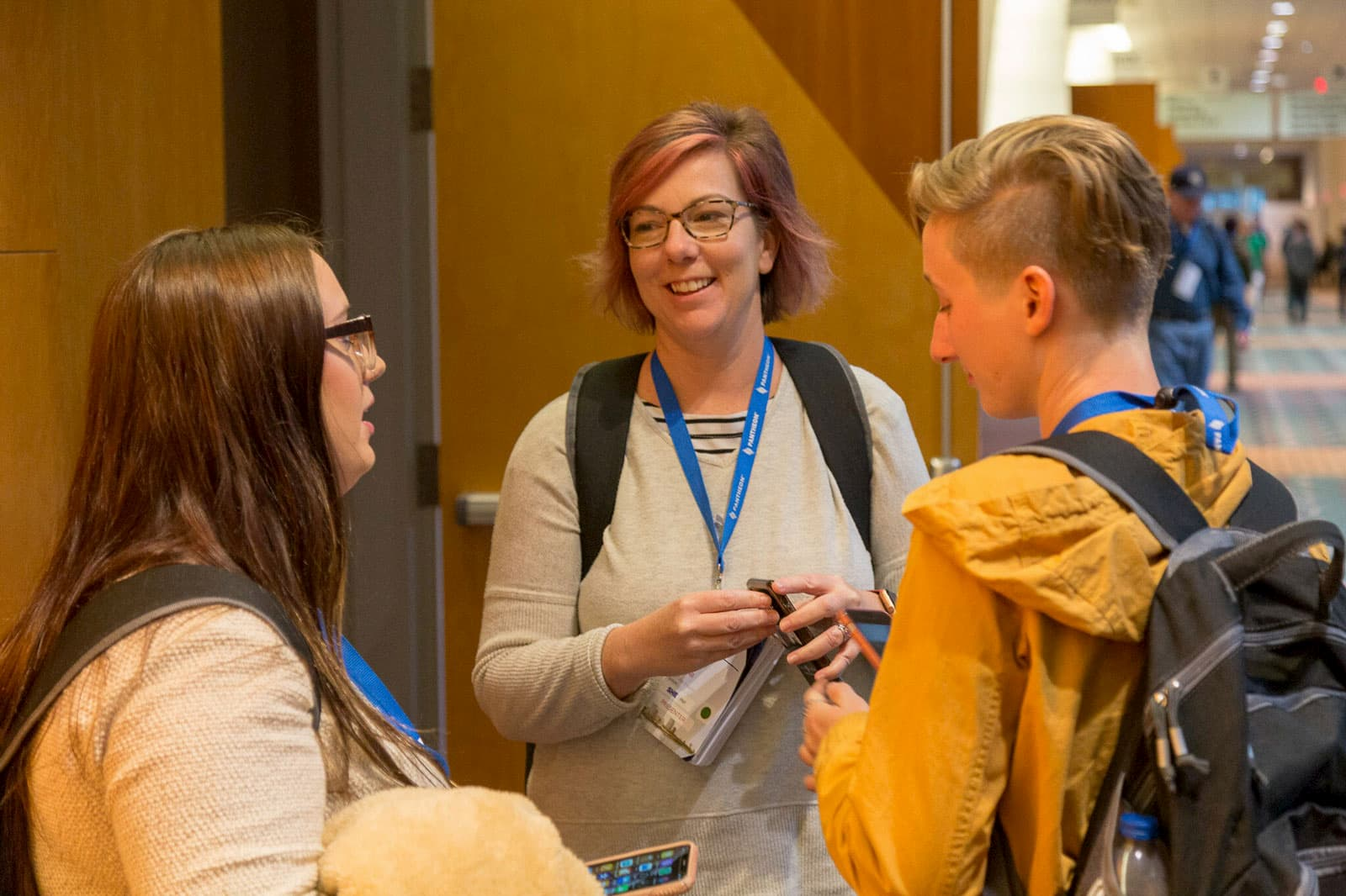 Attendees talk in the hallway during a break in sessions