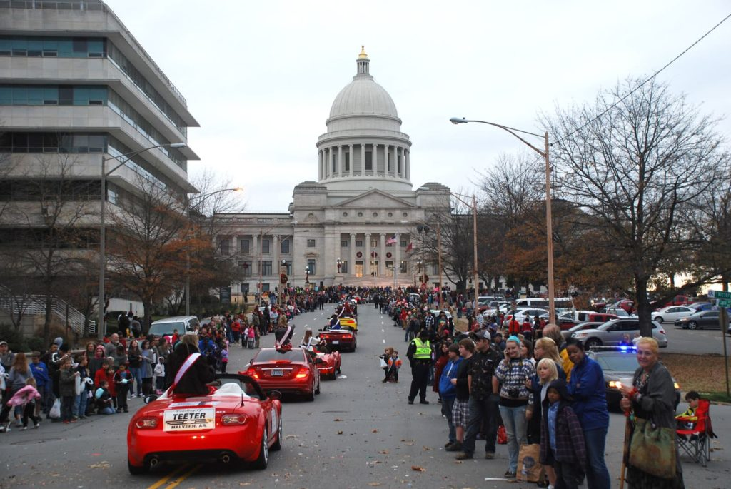 parade in Little Rock moving toward the Capitol building